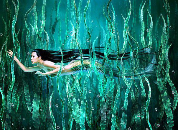Русалки плавают под водой в поисках украшений